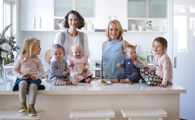 Fran Woods (left) and Jo Clark, the founders of Franjo's Kitchen, with their children.