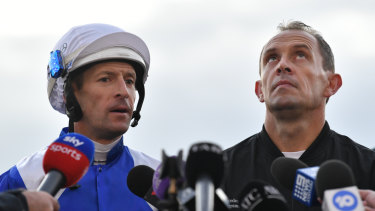 Once more with feeling: Hugh Bowman talks to the media as Chris Waller looks to the heavens after Winx's final track gallop on Thursday.