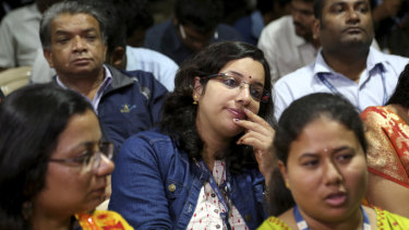 Indian Space Research Organisation (ISRO) employees react after the announcement.