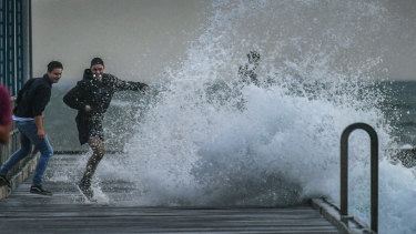 Wind whipping up waves at Frankston Pier on Tuesday.