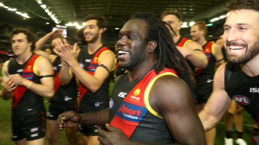 Bomber hero: Essendon's Anthony McDonald-Tipungwuti is the centre of attention after his late goal sealed victory over North Melbourne.
