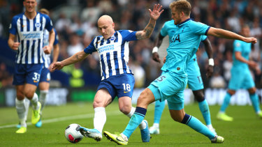 Aaron Mooy of Brighton & Hove Albion shields the ball from Eric Dier of Tottenham Hotspur at American Express Community Stadium.