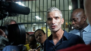 Craig Foster, left, and Francis Awartefe address the media outside the Thai court where Hakeem al-Araibi faces his extradition trial.