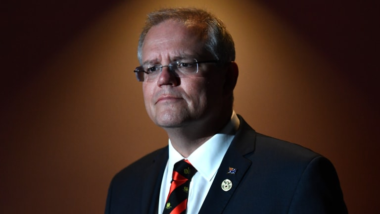 Prime Minister Scott Morrison says he will cut the number of migrants.