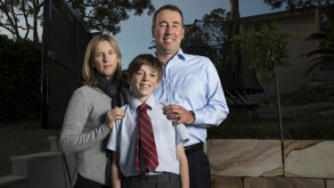Adrian and Sue Fisk with son Aidan in their Sydney backyard.