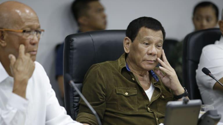 Philippine President Rodrigo Duterte, centre, and Defence Secretary Delfin Lorenzana, left, attend a command briefing on typhoon Mangkhut.