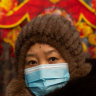 The coronavirus threat cast a pall over Lunar New Year celebrations in Beijing.