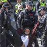 Dozens arrested as climate protest shuts down Princes Bridge, key tram routes