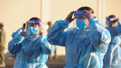 Masks 'part of the uniform', as teachers in PPE to supervise some VCE students