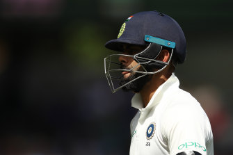 A dejected Virat Kohli after being dismissed by Josh Hazlewood in Sydney in January 2019.
