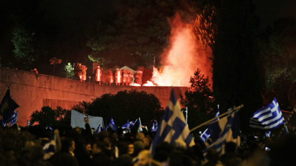 Greek police fire tear gas as thousands protest during Macedonia deal debate