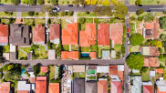 Up to a third of homes in parts of Melbourne and Sydney are being sold at a loss with the rate likely to climb higher.
