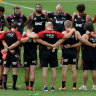 Quiet reflection: Crusaders players and staff pause during their captain's run on Friday in Sydney to remember those who lost their lives in the Christchurch terrorist attack.