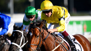 Hugh Bowman comes from last on Rocha Clock, one of four winners for the jockey at Randwick.