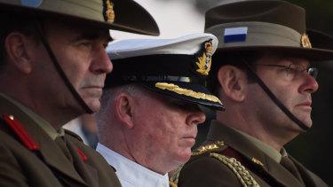 Servicemen listen to Premier Mark McGowan addressing the audience during his Anzac Day speech.