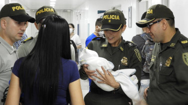 Colombia National Police, officers arrive to a hospital with an abandoned newborn baby girl who was discovered swaddled by a car near a stadium in Cucuta, Colombia.