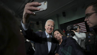 Democratic US presidential candidate and former vice-president Joe Biden smiles as he takes a selfie during a campaign stop in Exeter.