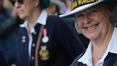 A Women's Royal Australian Naval Service Association WA member smiles during the Anzac March.