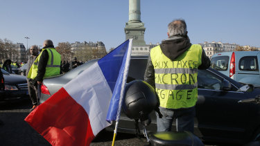 Protesters block the Place de la Bastille to protest against fuel taxes in Paris, France, on Saturday.