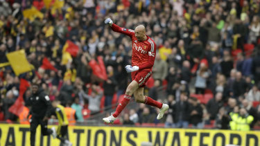 Watford goalkeeper Heurelho Gomes joins the celebrations as his side seals a 3-2 FA Cup semi-final in over Wolverhampton Wanderers.
