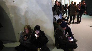 Basketball supporters wait to leave after a match in Strasbourg, France, while police hunted for the assailant.