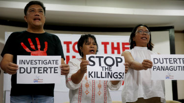Human rights advocates display placards during a news conference in suburban Quezon city, northeast of Manila, following the United Nations Human Rights Council's resolution in Geneva.