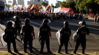 Police face demonstrators protesting US intervention in Venezuela outside the US embassy in Buenos Aires, Argentina, on Monday.