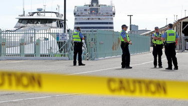 Police are seen at Fremantle Harbour on March 30 as Vasco da Gama passengers prepare for arrival at Rottnest island.