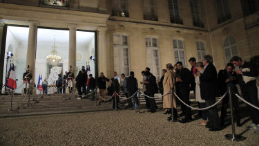 People line up to sign the condolences book to pay tribute to former President Jacques Chirac at the Elysee Palace on Thursday.