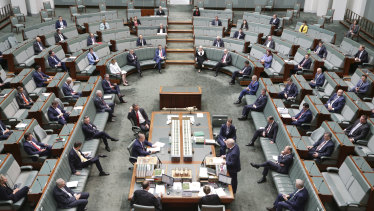 MPs observing social distancing when Parliament sat in March.