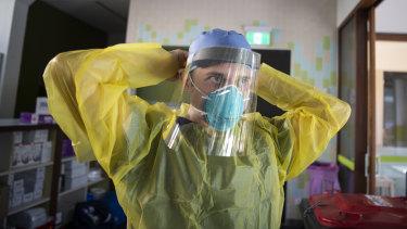 Nurse Jarrod Tunks prepares ahead of testing at the new Covid-19 clinic in Darlinghurst.