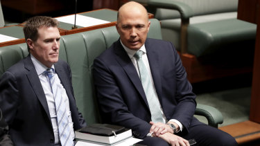 Backbencher and leadership aspirant Peter Dutton takes a seat next to Attorney-General Christian Porter during a division on Thursday.