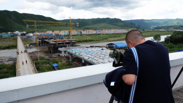 A Chinese tourist looks at North Korea from the Tumen side of the border.