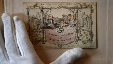 The world's first printed Christmas card is displayed at the Dickens Museum in London. The hand-coloured lithograph card was produced in 1843 and sold for one shilling.