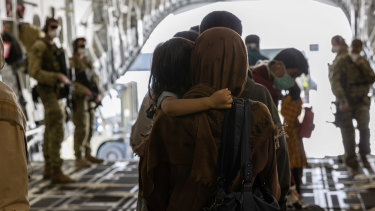 Afghanistan evacuees arrive at Australia's main operating base in the Middle East on August 21.