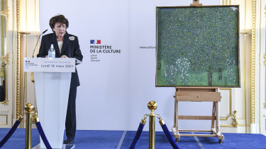 "French Culture Roselyne Bachelot speaks next to a oil painting by Gustav Klimt painted between in 1905 called ""Rosebushes under the Trees""."