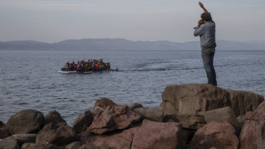 Asylum seekers aboard an overcrowded dinghy cross the Aegean Sea from Turkey to Lesbos in 2015.
