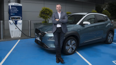 Hyundai Motor's manager of future mobility Scott Nargar with one of the carmaker's Kona EVs.