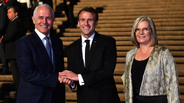 President of France Emmanuel Macron (centre) meets with Australia's Prime Minister Malcolm Turnbull and his wife Lucy Turnbull at the Sydney Opera House.