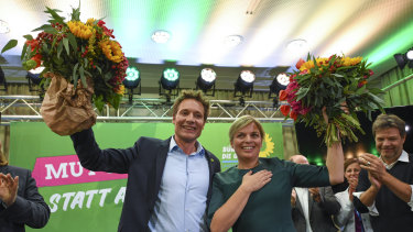 Greens candidates Ludwig Hartmann and Katharina Schulze  celebrate after the first exit polls for the Bavarian state election in Munich, southern Germany, on Sunday.