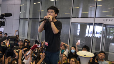 Joshua Wong addresses protesters gathered at the Legislative Council building.