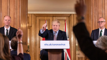 The UK's Chief Medical Officer Professor Chris Whitty (left) and Prime Minister Boris Johnson (centre) are self-isolating with COVID-19 symptoms.