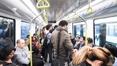 Passengers on a Metro Northwest driverless train this week.
