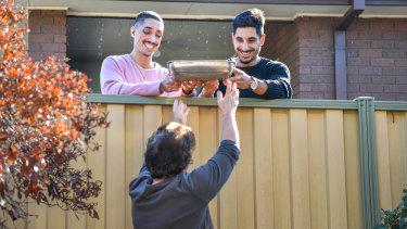 Luke and Daniel Mancuso with their next-door neighbour Nina.
