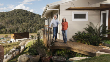 Tony and Teresa Farrell at the Narara housing community on the NSW Central Coast: they estimate that their greener house will save them $2000 a year.