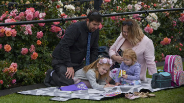 The Wogandt family travelled down from Queensland. Lily, 6, and Baylie, 3, with their parents Ken and Katie enjoyed a calm moment at Flemington before the rain pelted down.