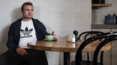 High St Society: Roosters co-captain Jake Friend enjoys a drink at the cafe he owns in Randwick.