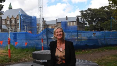 Principal of the new Inner Sydney High School, Robyn Matthews, with the school being built in the background.