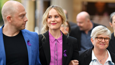 Actress Eryn-Jean Norvill (centre) leaves the Supreme Court in Sydney on Thursday.