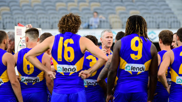 West is best: Adam Simpson addresses his team at three-quarter time during the Eagles' round one clash against the Demons.